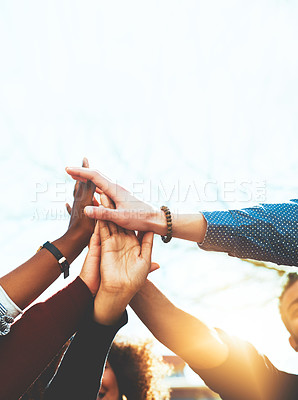Buy stock photo Cropped shot of an unrecognizable group of college friends high fiving while standing outside
