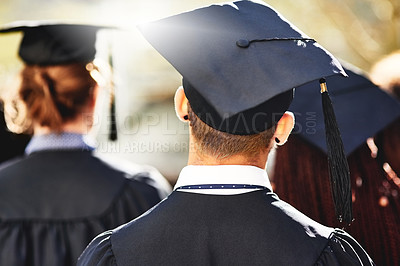 Buy stock photo Rearview shot of students on graduation day