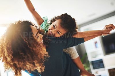 Buy stock photo Shot of a young mother and her daughter spending quality time together at home