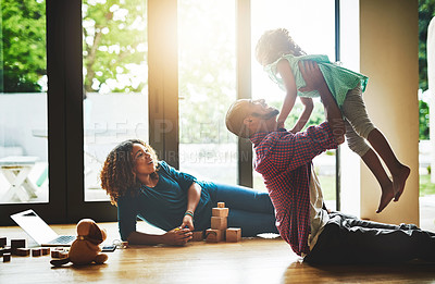 Buy stock photo Cropped shot of a family of three spending quality time together