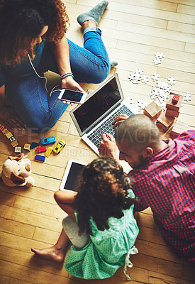 Buy stock photo Shot of a family of three using modern technology at home