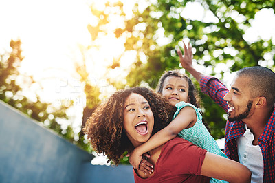 Buy stock photo Shot of a happy little girl and her parents having fun in their backyard