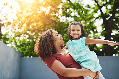 Buy stock photo Shot of a happy little girl and her mother having fun in their backyard