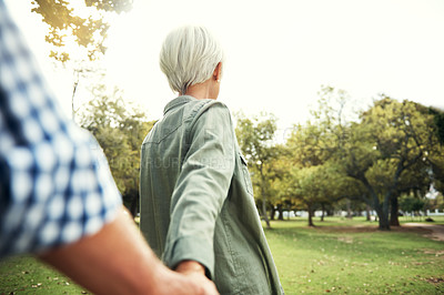Buy stock photo Shot of a senior couple holding hands in the park