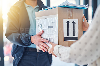 Buy stock photo Cropped shot of an unrecognizable delivery man handing a package to a female customer