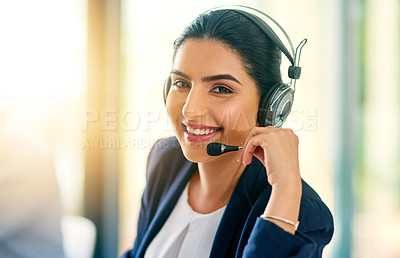 Buy stock photo Cropped portrait of an attractive young female customer care agent at work in her office