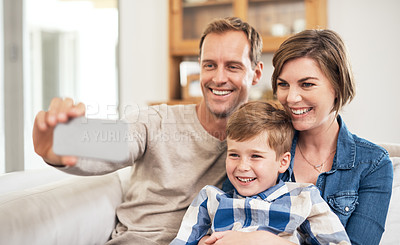 Buy stock photo Cropped shot of an affectionate young family of three taking selfies in their home