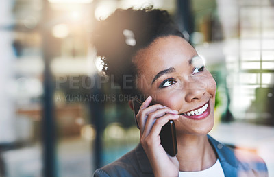 Buy stock photo Cropped shot of an attractive young businesswoman on a call in her office
