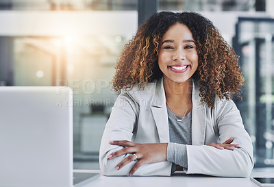 Buy stock photo Portrait of a young businesswoman sitting at her office desk