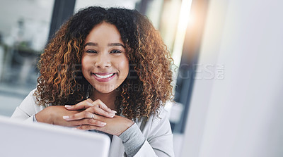 Buy stock photo Portrait of a young businesswoman working on a laptop in an office