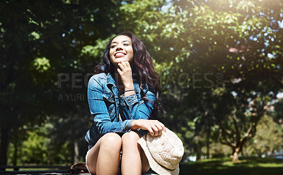 Buy stock photo Shot of an attractive young woman spending a day in the park