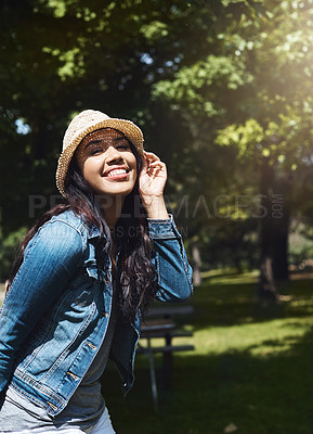 Buy stock photo Portrait of an attractive young woman spending a day in the park