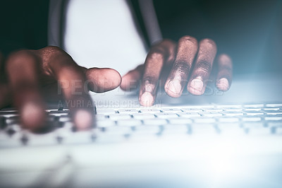 Buy stock photo Closeup shot of an unrecognizable man typing on a keyboard while working late in the office