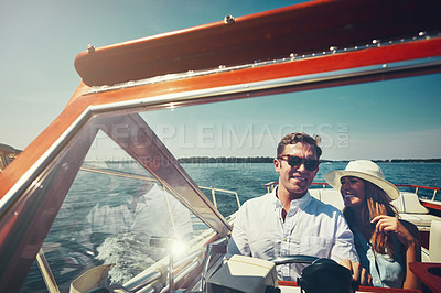 Buy stock photo Cropped shot of an affectionate young couple sailing on the open seas in their yacht