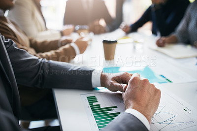 Buy stock photo Closeup shot of a group of unrecognizable businesspeople having a meeting in an office