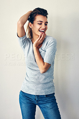 Buy stock photo Studio shot of an attractive young woman posing with her hair up