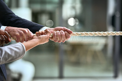 Buy stock photo Cropped shot of a group of businesspeople tugging on a rope in a modern office