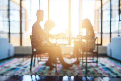 Buy stock photo Defocused shot of a group of designers having a meeting in an office