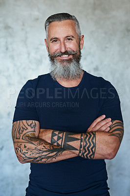 Buy stock photo Portrait of a confident middle aged man standing with his arms folded against a grey background