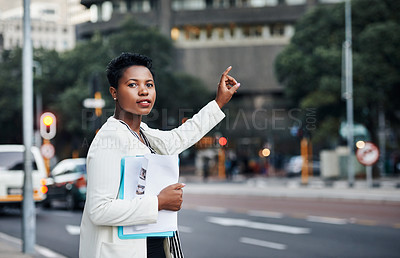 Buy stock photo Portrait of a young businesswoman catching a cab in the city