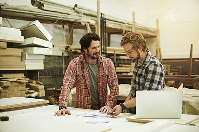 Buy stock photo Cropped shot of two craftsmen working together in a workshop