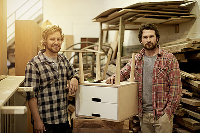 Buy stock photo Cropped shot of two craftsmen standing together in their workshop