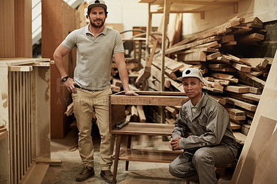 Buy stock photo Full length portrait of two handsome carpenters working in their worksop