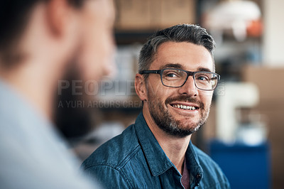 Buy stock photo Shot of a colleagues having a meeting in a workshop