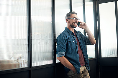 Buy stock photo Shot of a mature designer talking on a cellphone in an office