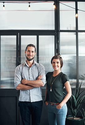 Buy stock photo Portrait of two young designers standing in an office