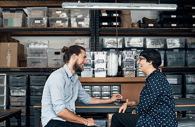 Buy stock photo Shot of two colleagues having a discussion in a workshop