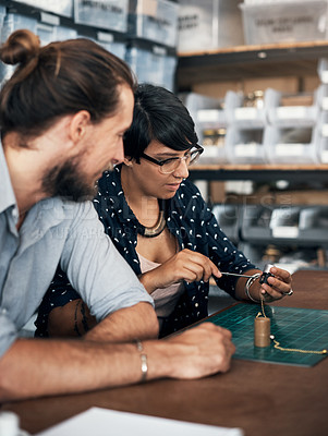 Buy stock photo Shot of two creatives working together in a workshop