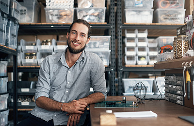 Buy stock photo Portrait of a young man sitting in a workshop