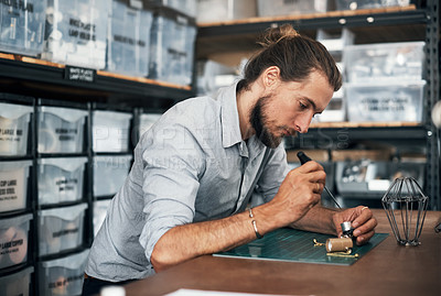 Buy stock photo Shot of a young man busy in a workshop