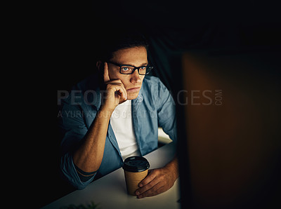 Buy stock photo Cropped shot of a young man working late in his office