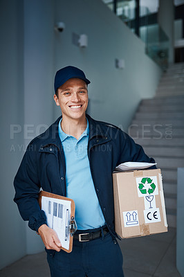 Buy stock photo Cropped shot of a handsome young man on his way to make a delivery