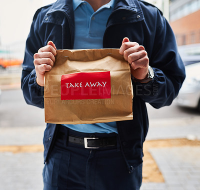 Buy stock photo Cropped shot of an unrecognizable man delivering take away food