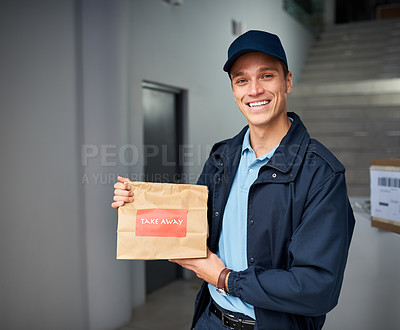 Buy stock photo Cropped shot of a handsome young man delivering take away food