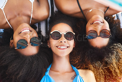 Buy stock photo High angle Portrait of a group of happy young women wearing sunglasses and relaxing at the beach