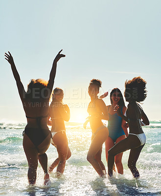 Buy stock photo Portrait of a group of happy young women having fun together at the beach