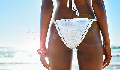 Buy stock photo Cropped shot of a beautiful young woman in a white bikini at the beach