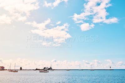 Buy stock photo Shot of boats on the ocean
