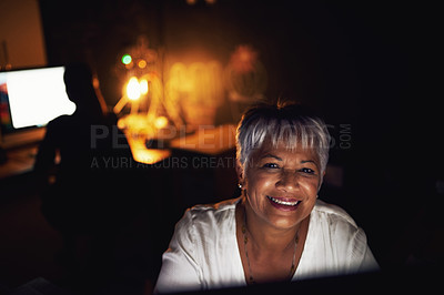 Buy stock photo Portrait of a mature businesswoman working late in an office
