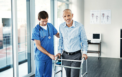 Buy stock photo Portrait of a senior patient with a walker getting assistance from a male nurse