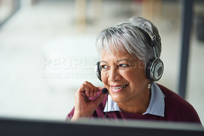Buy stock photo Shot of a mature woman working on a computer in a call centre