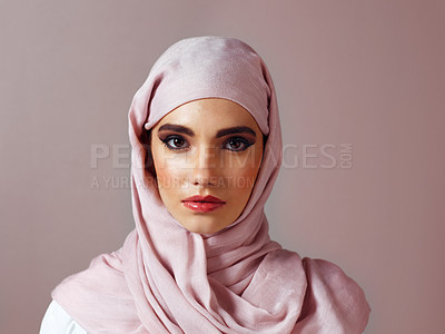 Buy stock photo Studio portrait of a cheerful young woman wearing a colorful head scarf while posing against a grey background