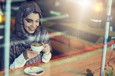 Buy stock photo Shot of a young woman having a cup of coffee in a cafe