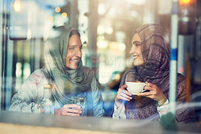 Buy stock photo Shot of two women chatting over coffee in a cafe
