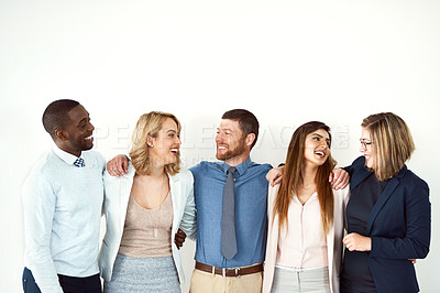 Buy stock photo Studio shot of a group of work colleagues standing with their arms around each other against a white background