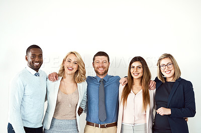 Buy stock photo Portrait of a group of work colleagues standing with their arms around each other against a white background